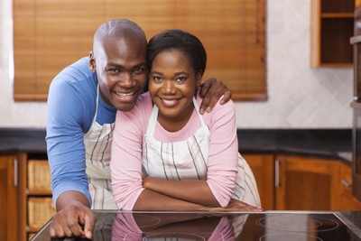 couple smiling near stove